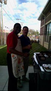 men at grill